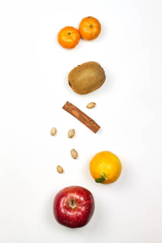 Vertically arranged fruits on white