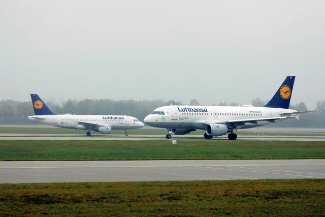 Two Lufthansa planes front to front in Munich Airport