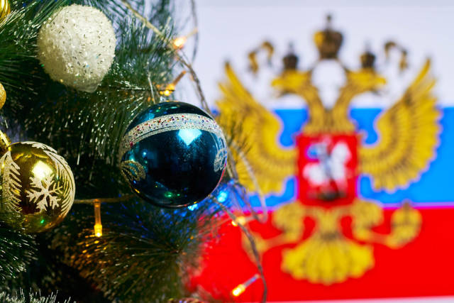 Decorated Christmas tree against the Russia flag
