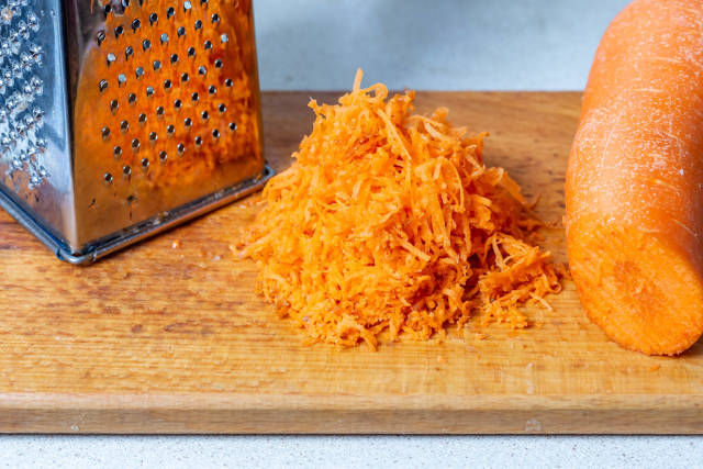 Grated carrots and grater