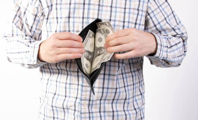Man in shirt showing open wallet