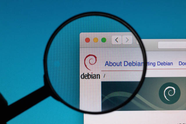 Debian logo under magnifying glass