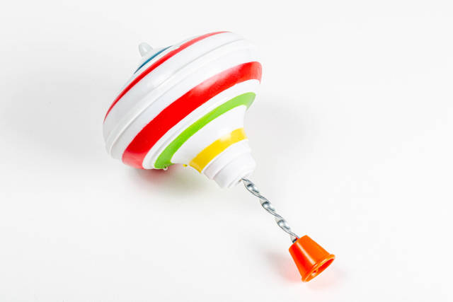 Childrens toy whirligig on a white background