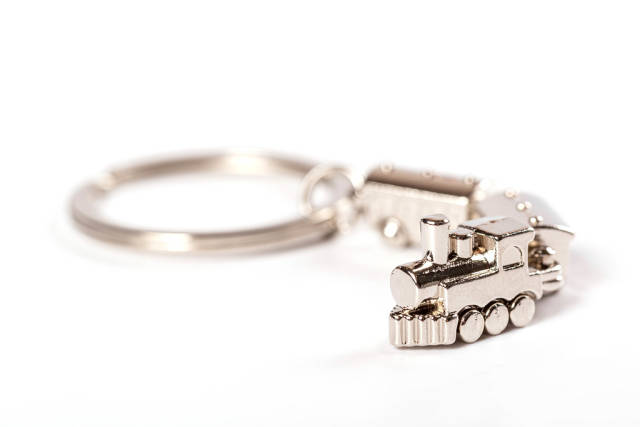 Key ring with a pendant shaped locomotive on white