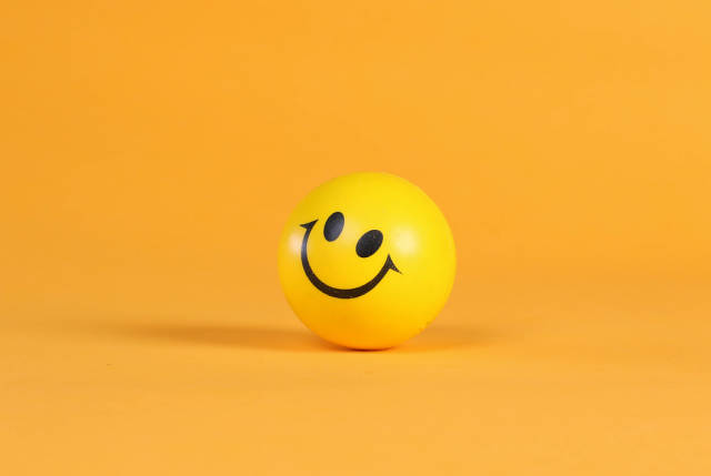Smiley face on yellow ball
