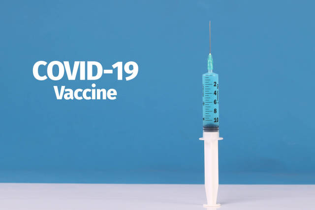 Medical syringe with COVID-19 Vaccine text