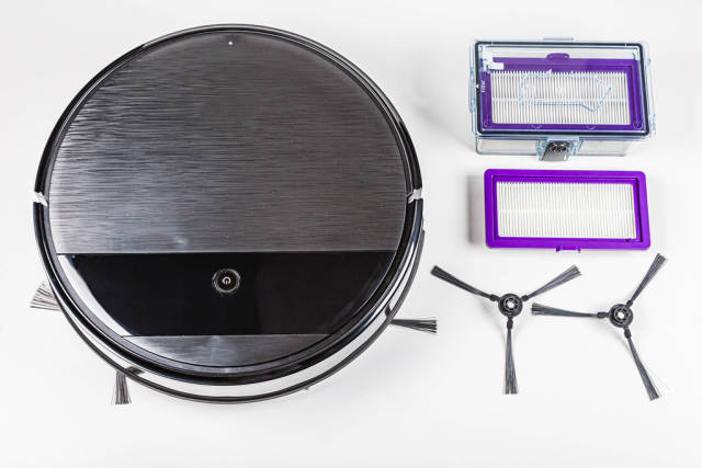 Top view, robot vacuum cleaner with replaceable filters and brushes