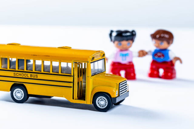 Yellow school bus toy and kids