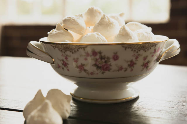 Delicate china bowl with meringue cookies