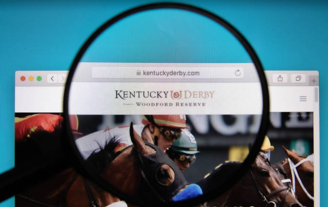 Kentucky Derby logo on a computer screen with a magnifying glass