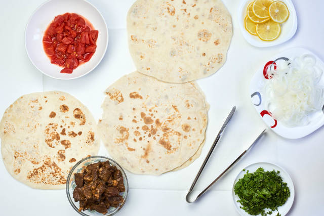 Preparing homemade shawarma. Easy making meal of Middle Eastern cuisine