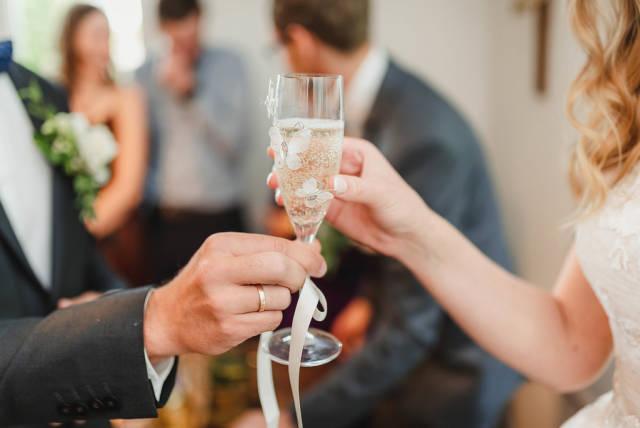 Happy Newlyweds Couple Drink Wedding Champagne