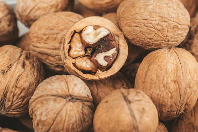 Background of ripe walnuts with shells