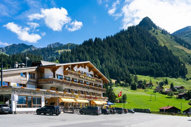Picturesque old hotel in Swiss countryside surrounded by mountains and hills