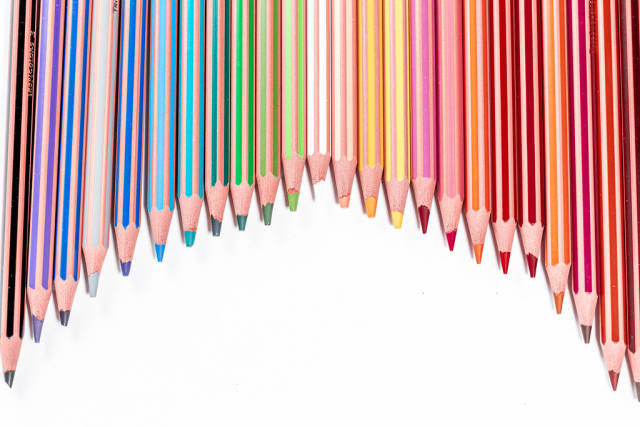 Arc of colored pencils with free space