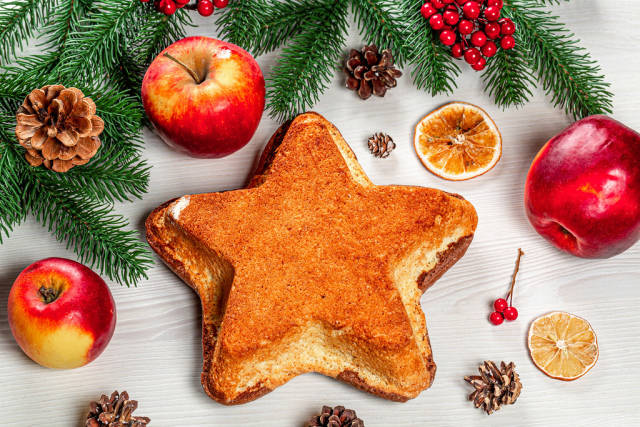 Top view of a homemade cake in the shape of a star on a Christmas background