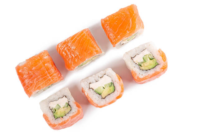 Sushi philadelphia with salmon on a white plate, top view