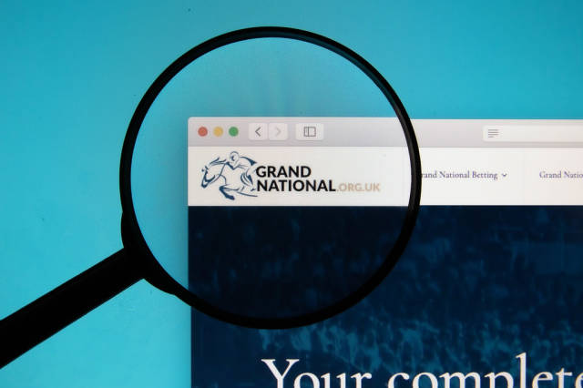 Grand National logo on a computer screen with a magnifying glass