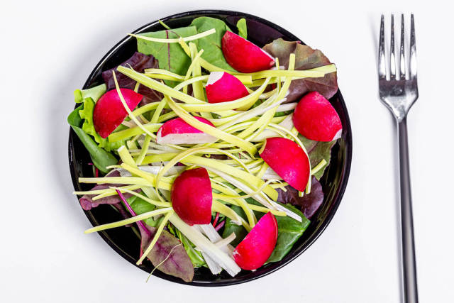 Top view fresh salad with spinach leaves, leeks and radishes