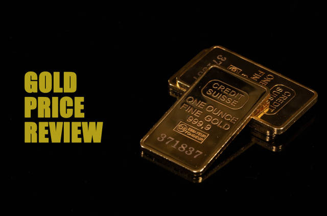 Gold bars with Gold Price Review text on black background