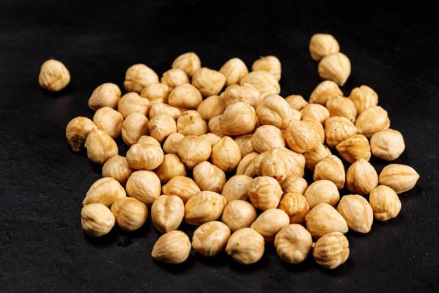 Roasted hazelnuts on a black background