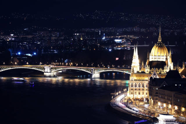 Budapest Palace of Parliament and bridges at night, view from above