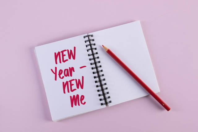 Open notebook with New Year New Me text