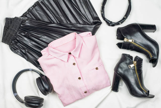 Female leather skirt, shoes with bright pink shirt on white