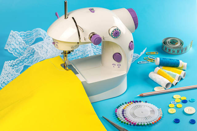 Sewing craft background with sewing machine and accessories