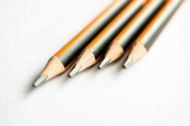 Row of black and orange pencils