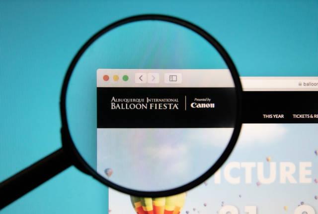 Albuquerque International Balloon Fiesta website with a magnifying glass