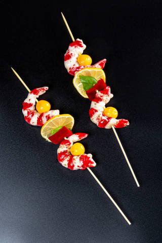 Delicious skewers of shrimp on a wooden sticks