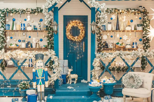 Beautiful blue and white background of decorated house for christmas