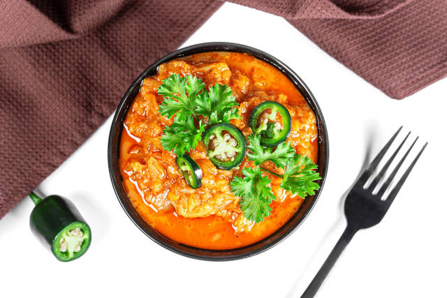 Vegetable stew with tomato sauce and hot pepper, top view