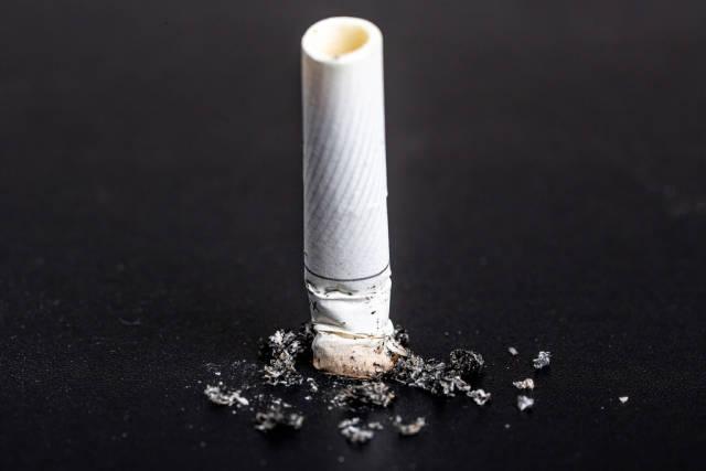 Cigarette butt on black background