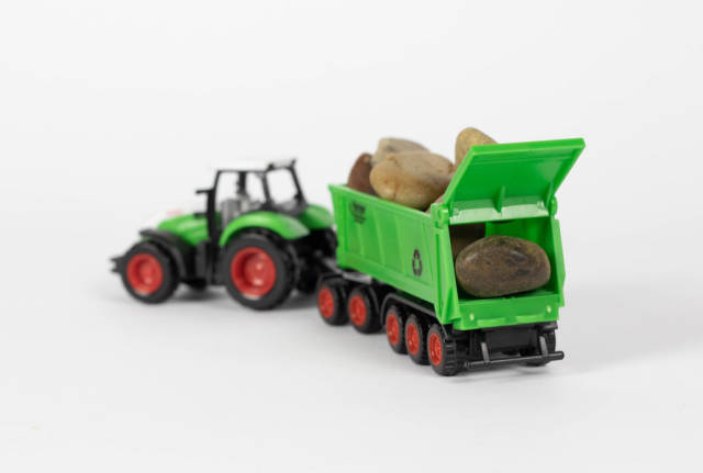 Tractor and wagon loaded with rocks