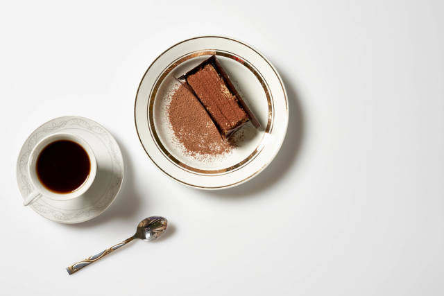 Breakfast - morning coffee with a slice of sweet cake