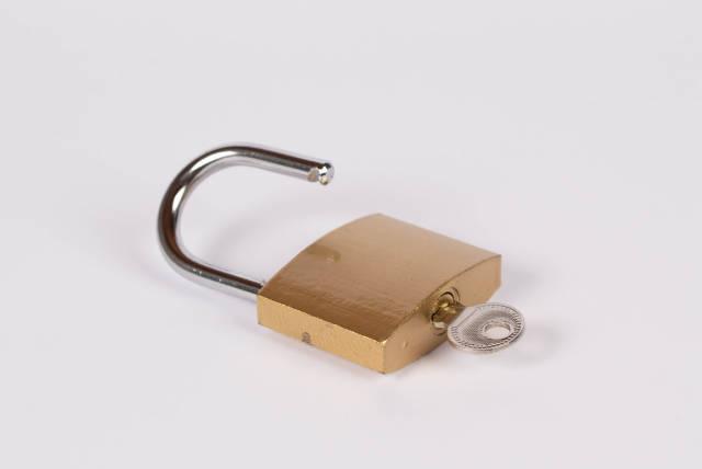 Lock and key on white background