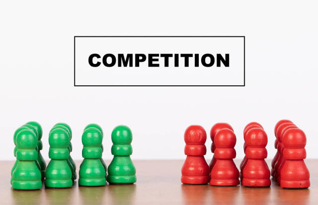Competition concept with pawn figurines on table