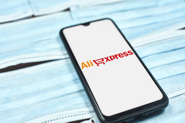 Aliexpress logo on mobile phone display. Impact of coronavirus on global business
