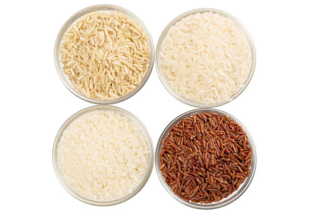 Set of four types of rice in glass bowls, top view