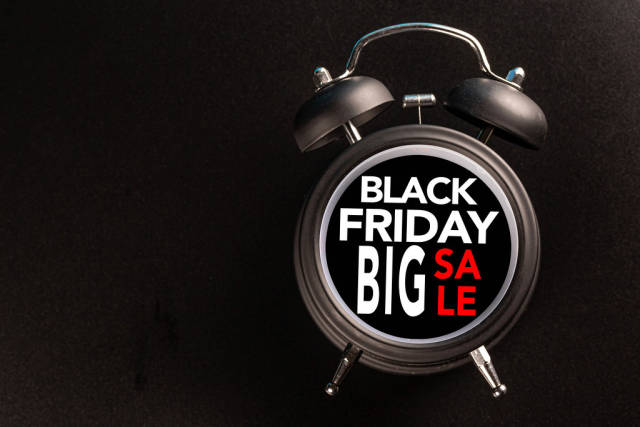 Black friday text with old analog clock. Black Friday sale concept