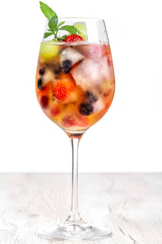 Drink glass with fruit ice and mint leaves