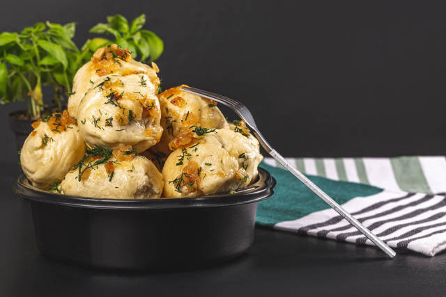 Boiled dumplings with herbs and fried onions
