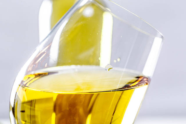 Close-up of a tilted glass of white wine