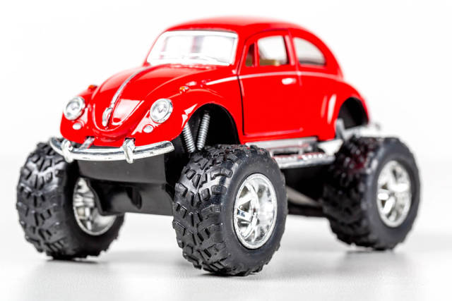 Volkswagen toy car with big wheels on a white background