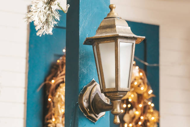 Close-up, lantern in front of the door with christmas wreath