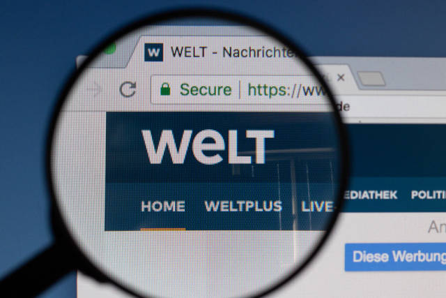 Welt logo on a computer screen with a magnifying glass