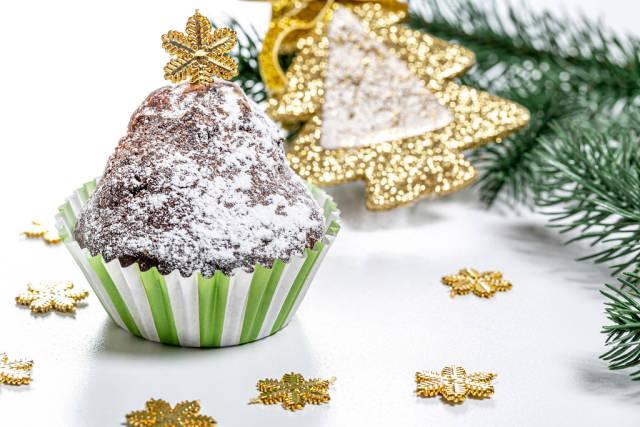 Chocolate cupcake on christmas background