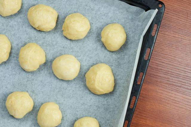 Sweet yeast dough on the oven pan